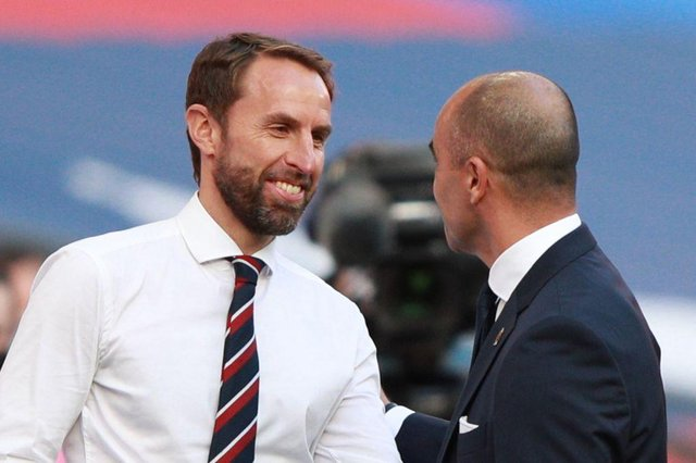 England's manager Gareth Southgate (L) greets Belgium's coach Roberto Martinez before the UEFA Nations League group A2 football match between England and Belgium at Wembley stadium in north London on October 11, 2020. (Photo by Ian Walton / POOL / AFP) / NOT FOR MARKETING OR ADVERTISING USE / RESTRICTED TO EDITORIAL USE (Photo by IAN WALTON/POOL/AFP via Getty Images)