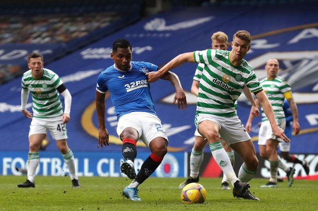 Alfredo Morelos of Rangers shoots under pressure from Kristoffer Ajer of Celtic during the Scottish Cup game between Rangers and Celtic at Ibrox Stadium on April 18, 2021 in Glasgow, Scotland.