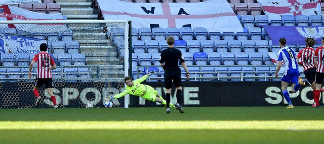 Lee Burge makes a save during Wigan Athletic's win at the DW Stadium
