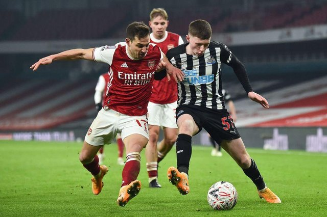 Elliot Anderson challenges Arsenal's Cedric Soares in an FA Cup tie.