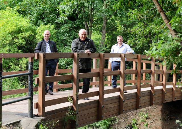 South Tyneside Council Cllr Ernest Gibson with ESH Civil's Steve Marshall and Stephen McClean on the newly installed bridge over the River Don at Mill Dene, Primrose, Jarrow.