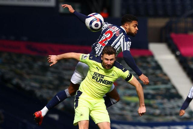 West Bromwich Albion's English defender Darnell Furlong (up) vies with Newcastle United's Welsh defender Paul Dummett during the English Premier League football match between West Bromwich Albion and Newcastle United at The Hawthorns stadium in West Bromwich, central England, on March 7, 2021.