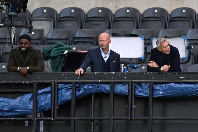 Former players and television presenters Micah Richards, Alan Shearer and Gary Lineker watch the match during the English FA Cup quarter-final football match between Newcastle United and Manchester City at St James' Park