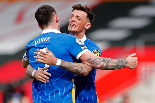 Lewis Dunk and Ben Whilte celebrates Brighton and Hove Albion's win over Southampton.
