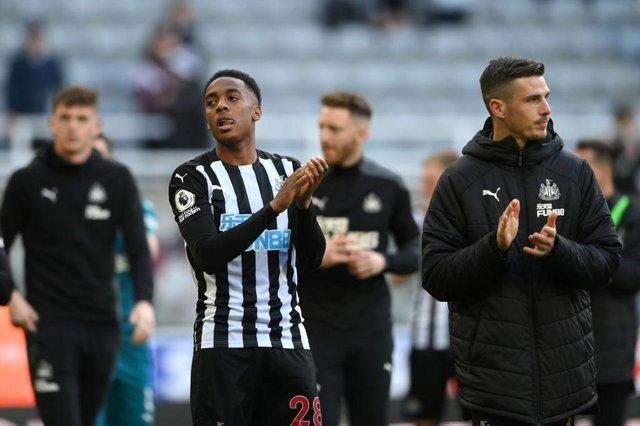 Joe Willock of Newcastle United applauds the fans after the Premier League match between Newcastle United and Sheffield United at St. James Park on May 19, 2021 in Newcastle upon Tyne, England.