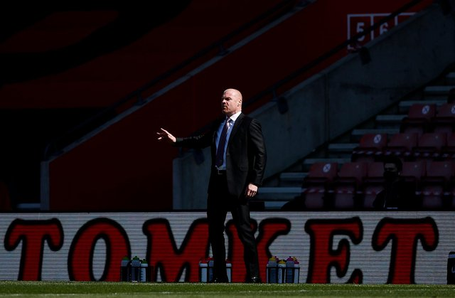 Sean Dyche, manager of Burnley, gives his team instructions during the Premier League match between Southampton and Burnley.