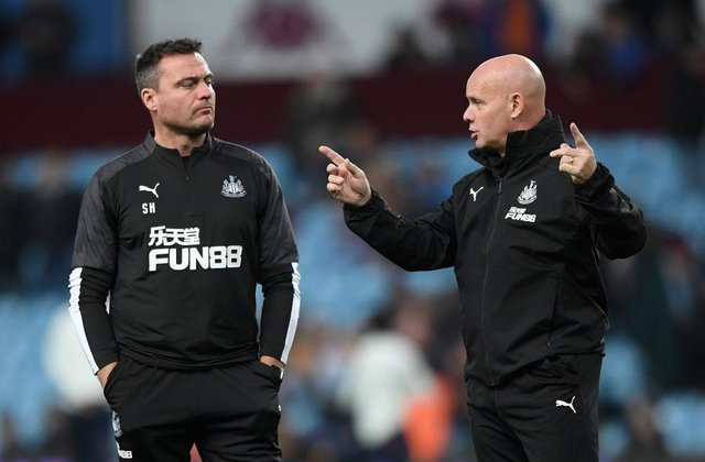 Newcastle coaches Steve Harper (l) and Steve Agnew chat during the warm up before the Premier League match between Aston Villa and Newcastle United at Villa Park on November 25, 2019 in Birmingham, United Kingdom.