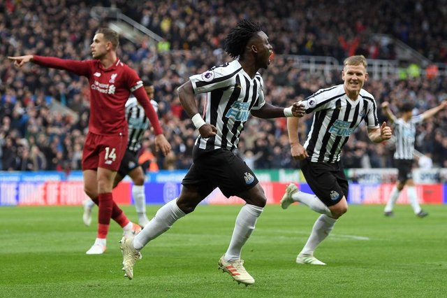Christian Atsu of Newcastle United celebrates after scoring his team's first goal during the Premier League match between Newcastle United and Liverpool FC at St. James Park on May 04, 2019 in Newcastle upon Tyne, United Kingdom.