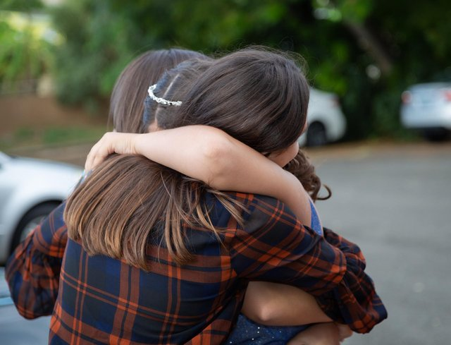 Hugging could return by May, so long as conditions allow