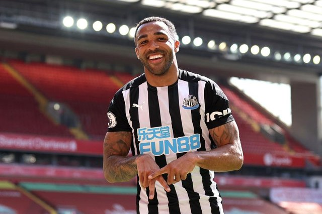 Callum Wilson of Newcastle United celebrates after scoring a goal which was later disallowed due to a handball during the Premier League match between Liverpool and Newcastle United at Anfield on April 24, 2021 in Liverpool, England.