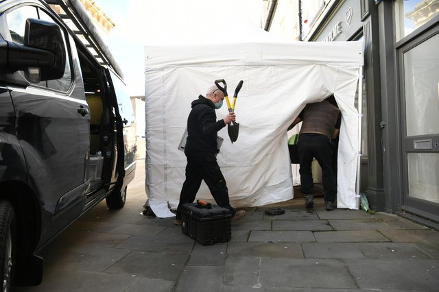 """Contractors arriving at The Clean Plate cafe in Southgate Street, Gloucester where excavation work is to begin after police found """"possible evidence"""" of where a suspected teenage victim of serial killer Fred West may be buried. Forensic archaeologists have been undertaking exploratory work in connection with the disappearance of 15-year-old Mary Bastholm who was last seen alive in January 1968. Picture date: Wednesday May 19, 2021."""