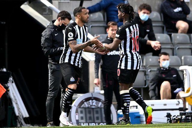 Callum Wilson of Newcastle United is substituted on for Allan Saint-Maximin  during the Premier League match between Newcastle United and West Ham United at St. James Park on April 17, 2021 in Newcastle upon Tyne, England.