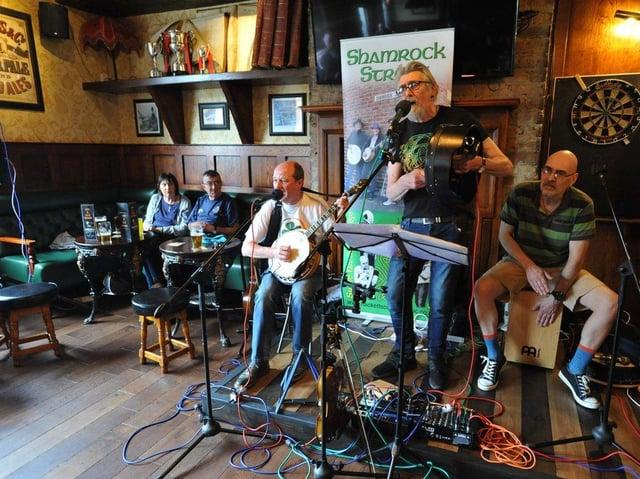 Shamrock Street performing their unique Irish music