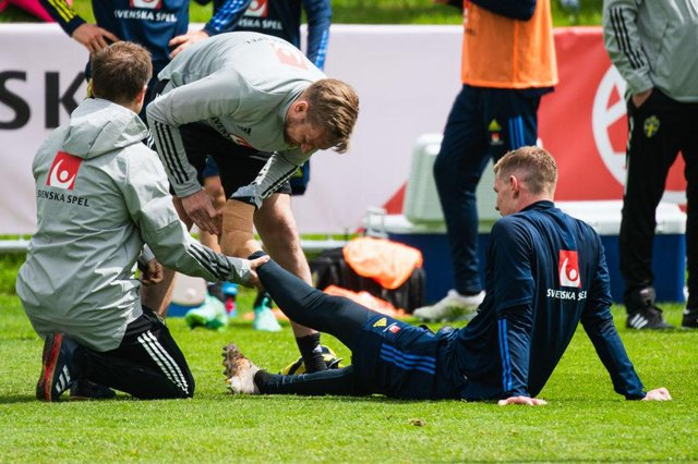 Sweden's defender Emil Krafth is treated during a training session on May 26, 2021 in Bastad, Sweden, where the Swedish national football team started its preparation for the upcoming EURO 2020 football tournament.