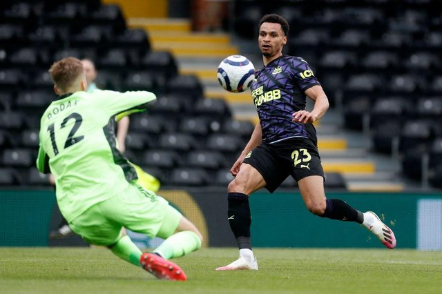 Newcastle United's English midfielder Jacob Murphy (R) shoots at goal in front of Fulham's Slovakian goalkeeper Marek Rodak (L) during the English Premier League football match between Fulham and Newcastle United at Craven Cottage in London on May 23, 2021.