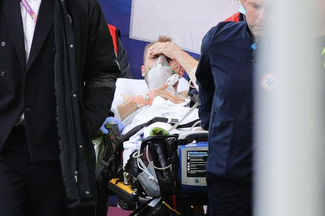 Christian Eriksen is taken to hospital after receiving CPR on the pitch.
