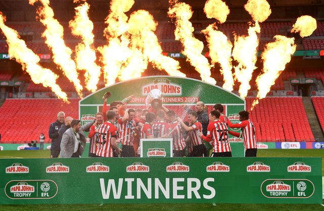 Sunderland players celebrate with the Papa John's Trophy after the Papa John's Trophy final.
