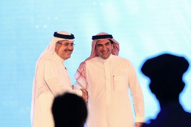 """President and CEO of Saudi Aramco Amin Nasser (L) shakes hands with Aramco's chairman Yasir al-Rumayyan after a press conference in the eastern Saudi Arabian region of Dhahran on November 3, 2019. - Saudi Aramco confirmed it planned to list on the Riyadh stock exchange, describing it as a """"significant milestone"""" in the history of the energy giant. (Photo by - / AFP) (Photo by -/AFP via Getty Images)"""