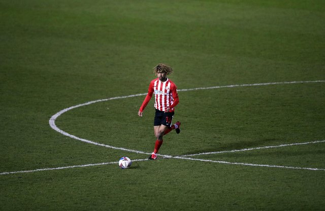 Dion Sanderson of Sunderland in action during the Sky Bet League One match between Shrewsbury Town and Sunderland at Montgomery Waters Meadow on February 09, 2021 in Shrewsbury.