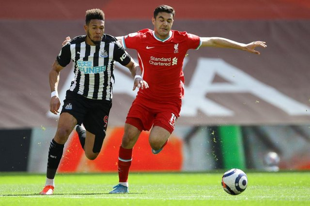 Newcastle United's Brazilian striker Joelinton (L) vies with Liverpool's Turkish defender Ozan Kabak during the English Premier League football match between Liverpool and Newcastle United at Anfield in Liverpool, north west England on April 24, 2021.
