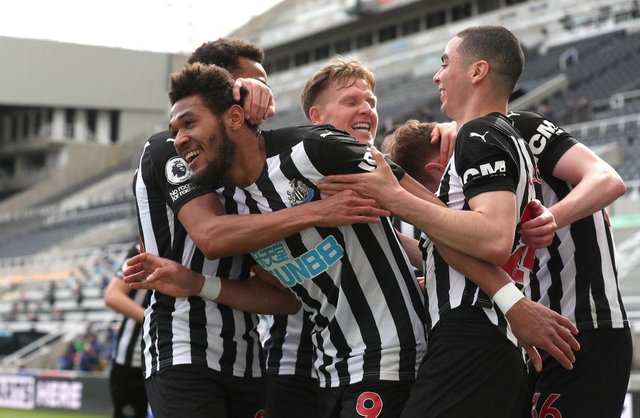 Joelinton of Newcastle United celebrates with team mates after scoring their side's first goal during the Premier League match between Newcastle United and Tottenham Hotspur at St. James Park on April 04, 2021 in Newcastle upon Tyne, England.