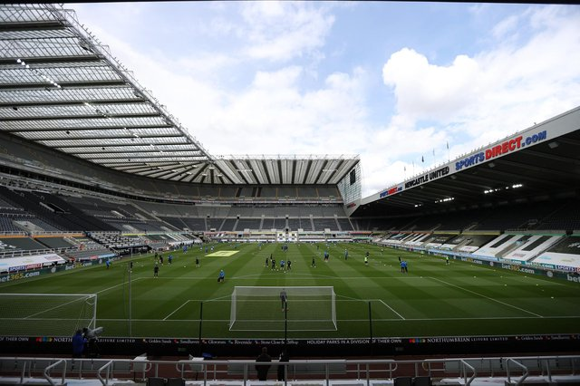 General view inside the stadium as both teams warm-up prior to the Premier League match between Newcastle United and Arsenal at St. James Park.
