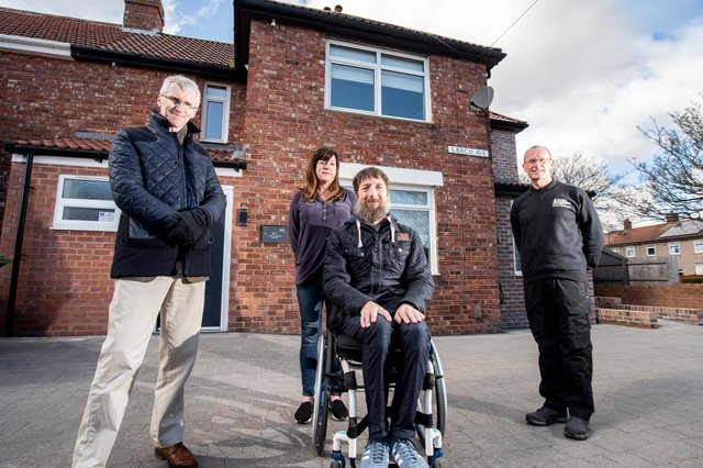 (l-r) Neil Turner, Director- Howarth Litchfield accompanies Andrea Burns and Jason Burns, war veteran plus Jonathan Ball, Chief Executive- RMA- The Royal Marines Charity for a first look around their new home