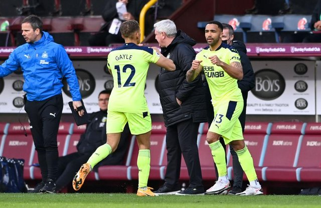 Dwight Gayle of Newcastle United is replaced by Callum Wilson of Newcastle United during the Premier League match between Burnley and Newcastle United at Turf Moor on April 11, 2021 in Burnley, England.