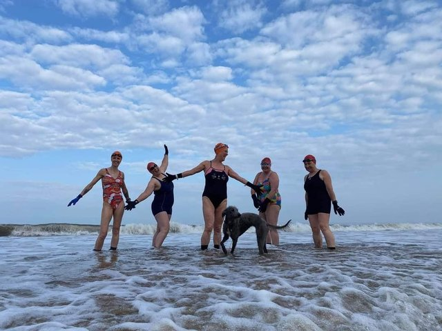 Sarah Thorell pictured with Helen Collins Lindy Woodrow Alison Symonds Norma Thompson along with Kipper the dog.