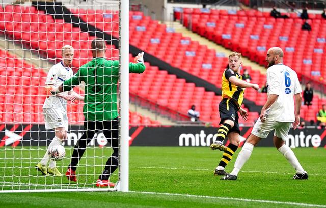 Hebburn Town's Thomas Potter (centre) shoots towards goal during the Buildbase FA Vase 2019/20 Final at Wembley Stadium, London. PA picture.