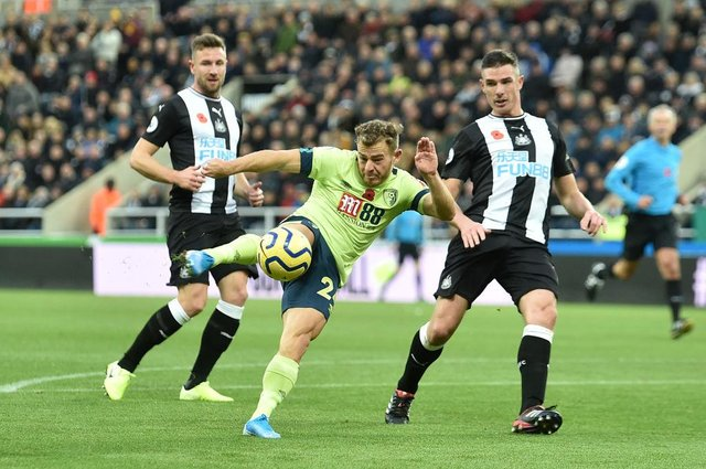 Ryan Fraser of AFC Bournemouth shoots during the Premier League match between Newcastle United and AFC Bournemouth  at St. James Park on November 09, 2019 in Newcastle upon Tyne, United Kingdom.