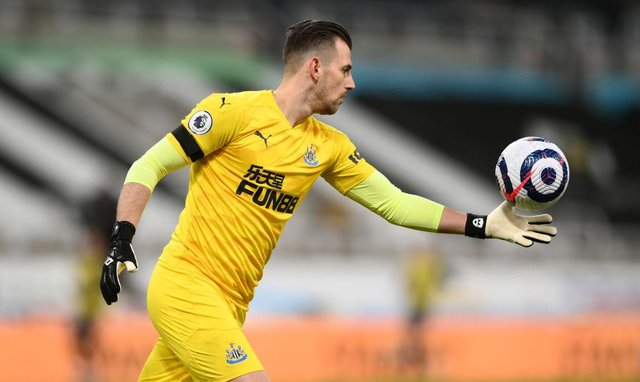Newcastle goalkeeper Martin Dubravka kicks the ball upfield during the Premier League match between Newcastle United and Aston Villa at St. James Park on March 12, 2021 in Newcastle upon Tyne, England.