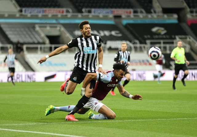 Tyrone Mings of Aston Villa is brought down by Joelinton of Newcastle United during the Premier League match between Newcastle United and Aston Villa at St. James Park on March 12, 2021 in Newcastle upon Tyne, England.