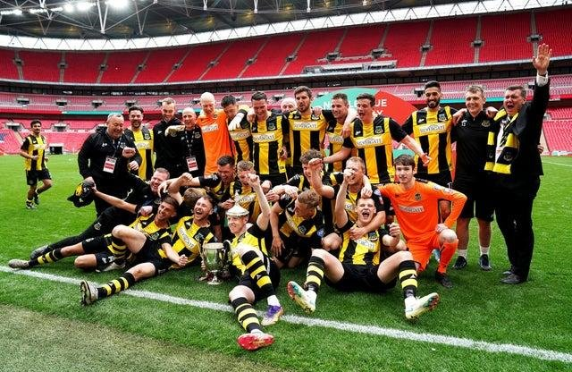 Hebburn Town players and staff celebrate with the Buildbase FA Vase 2019/20 Trophy after the Final at Wembley Stadium, London.