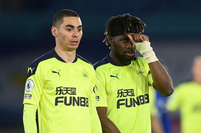 Miguel Almiron and Allan Saint-Maximin of Newcastle look on during the Premier League match between Leicester City and Newcastle United at The King Power Stadium on May 07, 2021 in Leicester, England.