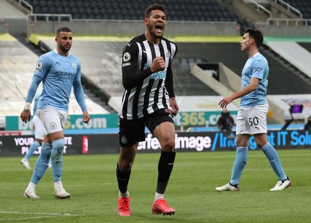 Joelinton celebrates his penalty.