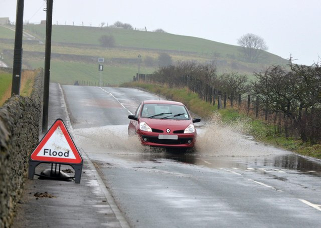 Flooding on Lizard Lane, Whitburn, in recent years. There are now plans to tackle the problem.