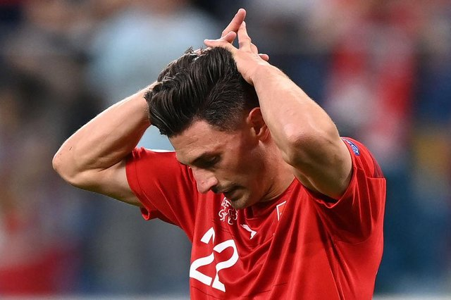Fabian Schar reacts to his saved penalty.