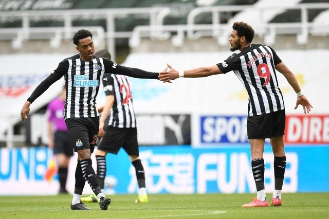 Newcastle United's English midfielder Joe Willock (L) celebrates scoring his team's second goal with Newcastle United's Brazilian striker Joelinton (R) during the English Premier League football match between Newcastle United and Tottenham Hotspur at St James' Park in Newcastle-upon-Tyne, north east England on April 4, 2021.