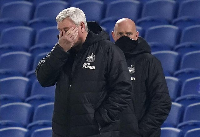Newcastle United's English head coach Steve Bruce (L) reacts during the English Premier League football match between Brighton and Hove Albion and Newcastle United at the American Express Community Stadium in Brighton, southern England on March 20, 2021.