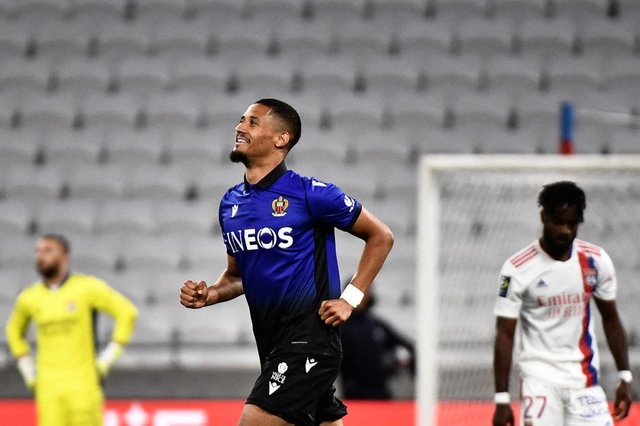 Nice's French defender William Saliba celebrates scoring his team's third goal during the French L1 football match between Lyon (OL) and OGC Nice at The Groupama Stadium in Decines-Charpieu, near Lyon, central-eastern France on May 23, 2021. (Photo by JEFF PACHOUD / AFP) (Photo by JEFF PACHOUD/AFP via Getty Images)