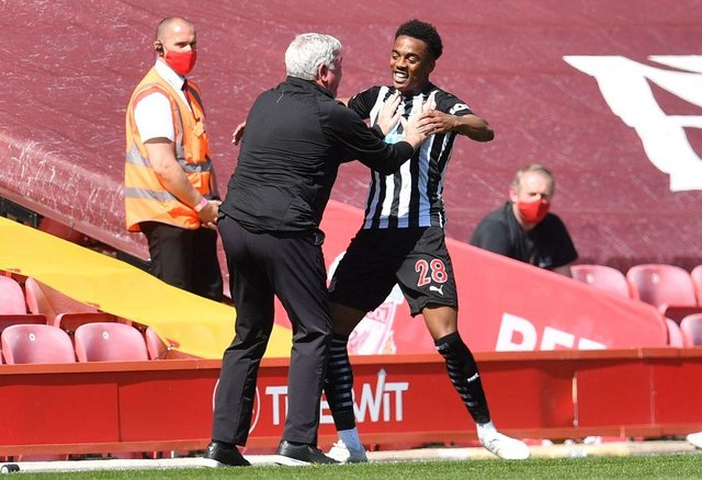 Newcastle United head coach Steve Bruce pictured celebrating with Joe Willock, who scored a late equaliser at Liverpool. (Photo by PAUL ELLIS/POOL/AFP via Getty Images)