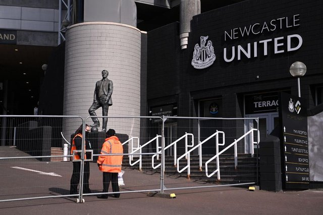 General view outside the stadium as stewards speak inside temporary fencing, prior to the Premier League match between Newcastle United and West Ham United at St. James Park on April 17, 2021 in Newcastle upon Tyne, England.