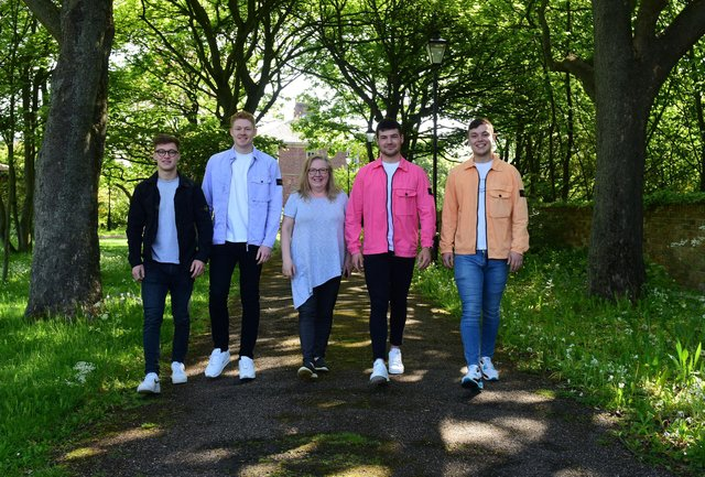 Angie Angus (centre) of Mental Health Concern, with four lads who have raised over £3000 for the charity, l-r Ethan Proud,Ben Robson, Nathan Johnson and Matthew Foster.