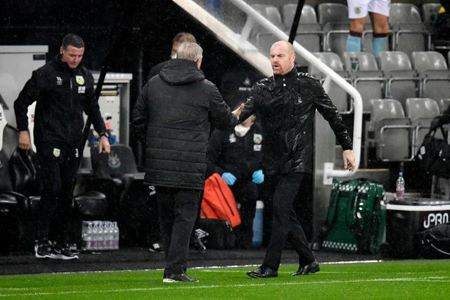 Steve Bruce, Manager of Newcastle United shakes hands with Sean Dyche, Manager of Burnley following the Premier League match between Newcastle United and Burnley at St. James Park. (Photo by Peter Powell - Pool/Getty Images)