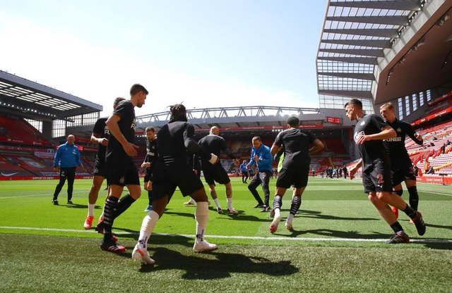 The Newcastle United team warm up prior to the Premier League match between Liverpool and Newcastle United at Anfield on April 24, 2021 in Liverpool, England.