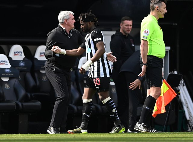 Newcastle player Allan Saint -Maximin is congratulated by manager Steve Bruce after being substituted during the Premier League match between Newcastle United and West Ham United at St. James Park