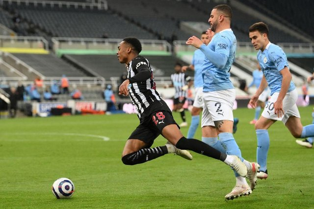 Manchester City's English defender Kyle Walker (2R) fouls Newcastle United's English midfielder Joe Willock to concede a penalty during the English Premier League football match between Newcastle United and Manchester City at St James' Park in Newcastle-upon-Tyne, north east England on May 14, 2021.