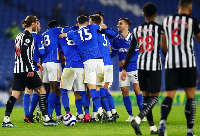 Leandro Trossard of Brighton & Hove Albion celebrates with teammates after scoring their team's first goal during the Premier League match between Brighton & Hove Albion and Newcastle United.