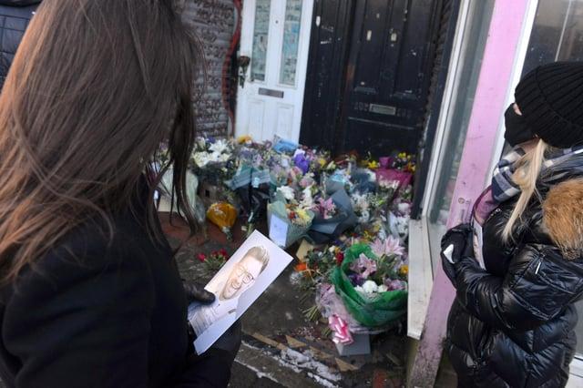 Tributes were left outside Stoney's Barber Shop.